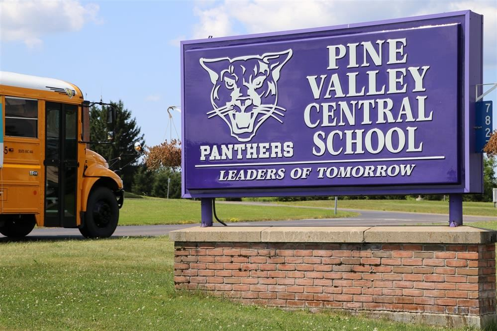Pine Valley Central School Sign with bus in background
