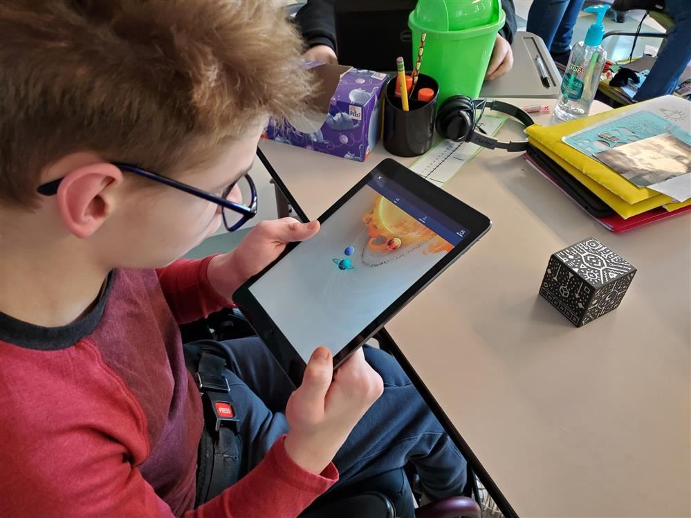 Students working with CoSpaces and Merge Cube