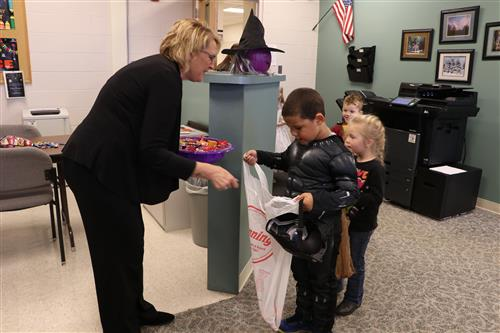 Elementary students trick-or-treating