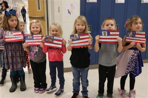 Kindergarteners holding flag they made