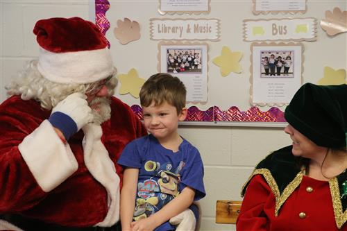 Little boy with Santa and his Elf