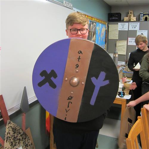 student with shield project
