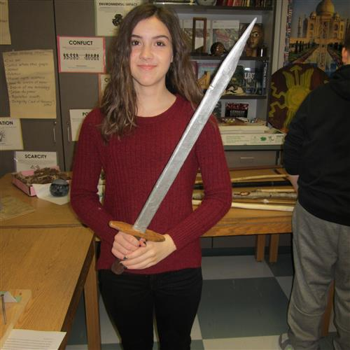 student with sword project