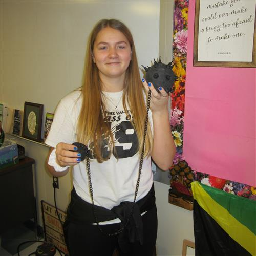 student with ball and chain project