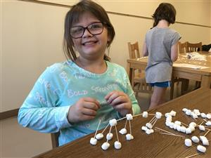 Smiling student working on steam activity